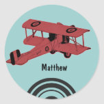 Pegatina rojo del biplano del vintage