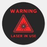 Pegatina rojo del símbolo amonestador de laser