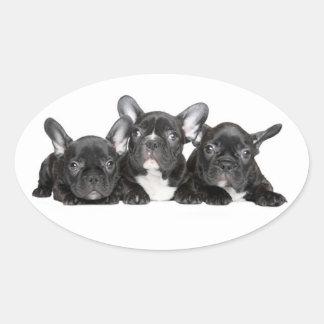 Pegatina/sello negros del perro de perrito del pegatina ovalada