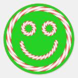 Pegatina sonriente de la cara del bastón de carame
