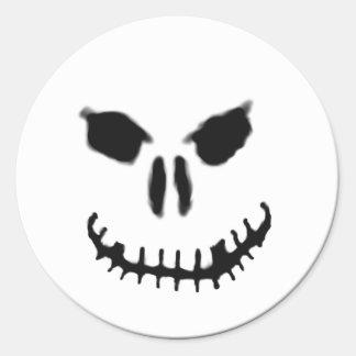 Pegatina sonriente del cráneo