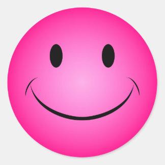 Pegatina sonriente rosado de la cara