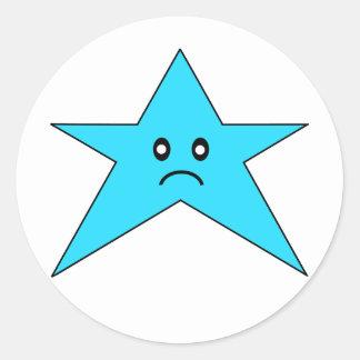Pegatina triste azul de la estrella