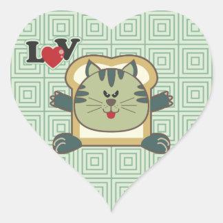 Pegatina verde del corazón del gato que empana