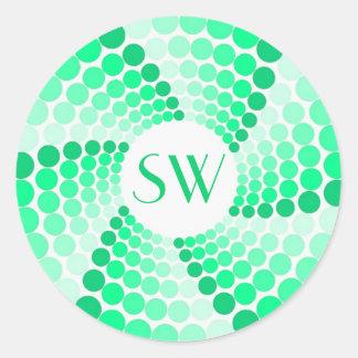 Pegatina verde del monograma del remolino del