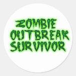 pegatinas del superviviente del brote del zombi etiqueta redonda