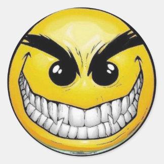 Pegatinas redondos de la cara sonriente malvada pegatinas redondas