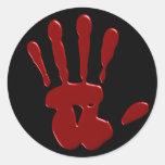 Pegatinas sangrientos de la mano izquierda etiquetas redondas