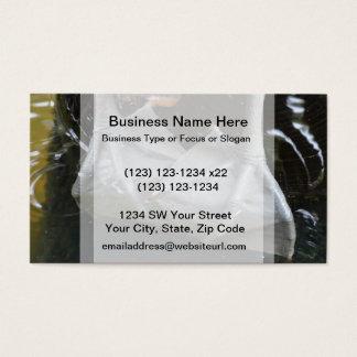 pelican feet closeup on log business card