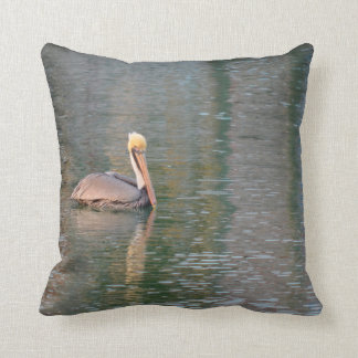pelican floating in river colorful reflections pillow