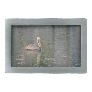 pelican floating in river colorful reflections rectangular belt buckle
