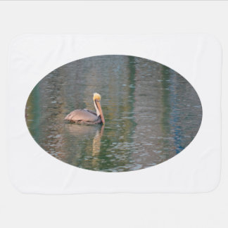 pelican floating in river colorful reflections baby blanket