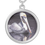 Pelican Gliding Along Round Pendant Necklace