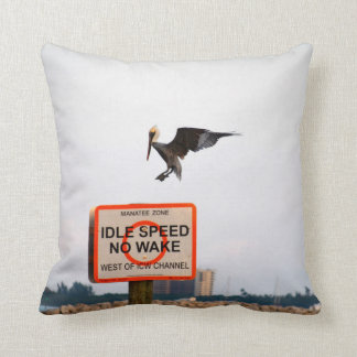 pelican landing on channel sign in florida throw pillow