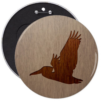 Pelican silhouette engraved on wood design button