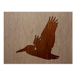 Pelican silhouette engraved on wood design postcard
