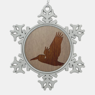 Pelican silhouette engraved on wood design snowflake pewter christmas ornament