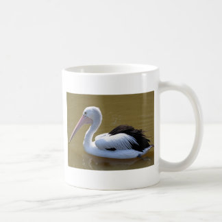 Pelican swimming on river coffee mug