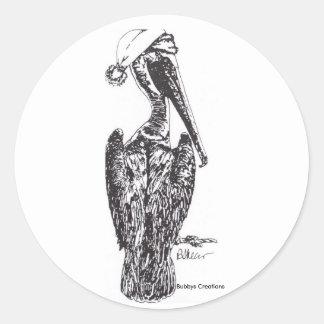 Pelícano con el gorra etiqueta redonda