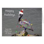 Pelícano que adorna para el navidad tarjeta de felicitación
