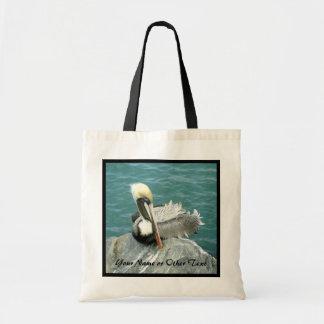 Pelícano que se sienta personalizado bolsa tela barata