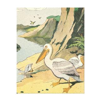 Pelícanos en una playa rocosa impresión en lona estirada