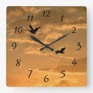 Pelicans at Sunset Square Wall Clock