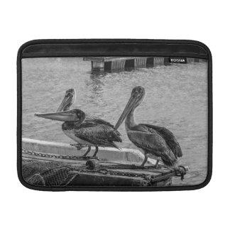 Pelicans at the harbor MacBook air sleeve