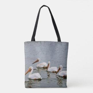 Pelicans looking for food tote bag