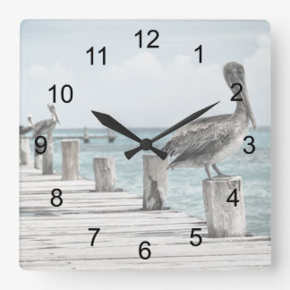 Pelicans On The Pier Square Wall Clock