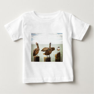 Pelicans perched on posts baby T-Shirt