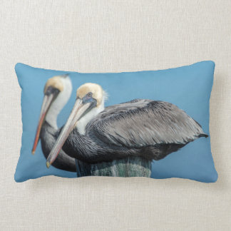 Pelicans roosting on pylon throw pillows
