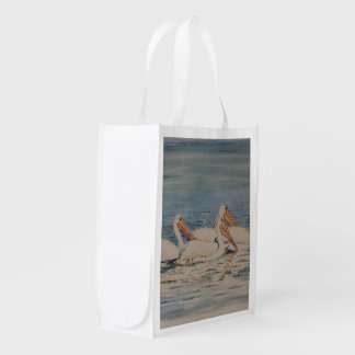 Pelicans Swimming on Calm Waters Grocery Bag