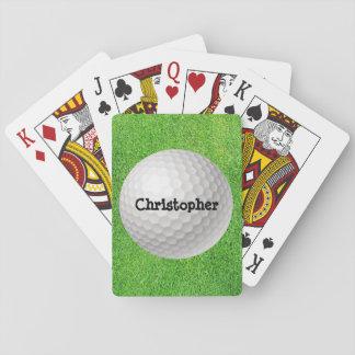 Pelota de golf en naipes verdes barajas de cartas