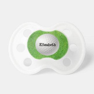 Pelota de golf en pacificador verde chupetes