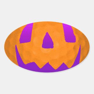 Pelota de golf púrpura de Halloween del resplandor Pegatina Ovalada