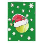Pelota de tenis con la tarjeta de Navidad del gorr