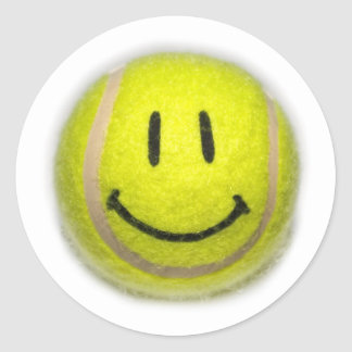 Pelota de tenis sonriente de la cara pegatina redonda