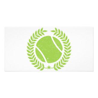 Pelota de tenis y diseño del vintage del equipo de tarjeta fotográfica