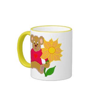 Peluche con la taza de la flor