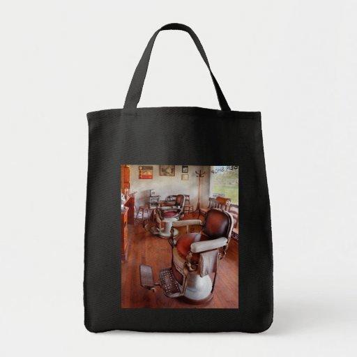 Peluquero - tenga por favor un asiento bolsa