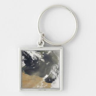 Penachos del polvo que descargan la costa africana llavero cuadrado plateado