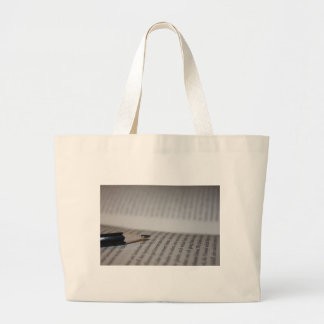 Pencil on book pages bag