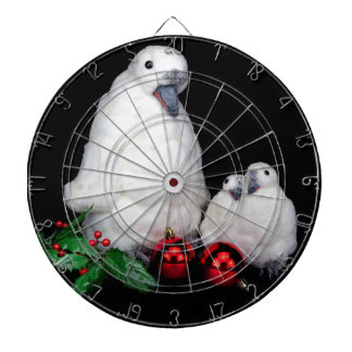Penguin figurines as family with christmas balls dartboard with darts