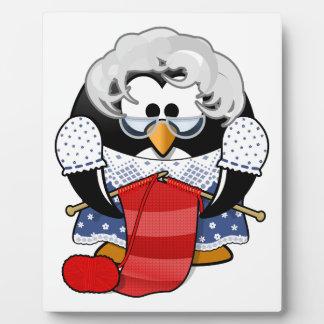 Penguin grandma knitting animation illustration plaque
