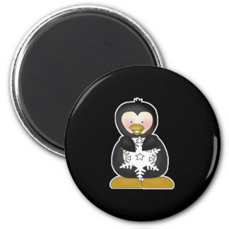 penguin holding snowflake 2 inch round magnet