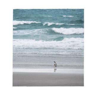 Penguin returning from the ocean notepad