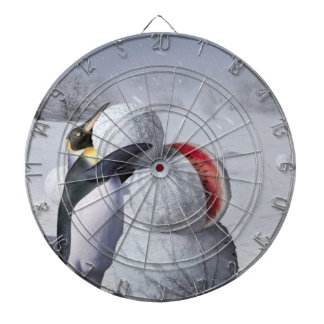 Penguin snowman dartboard with darts