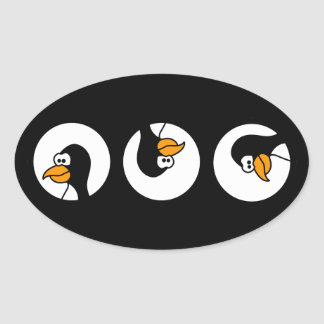 Penguin turns in circles oval sticker