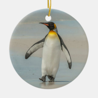 Penguin walking on the beach ceramic ornament